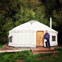 A small white yurt