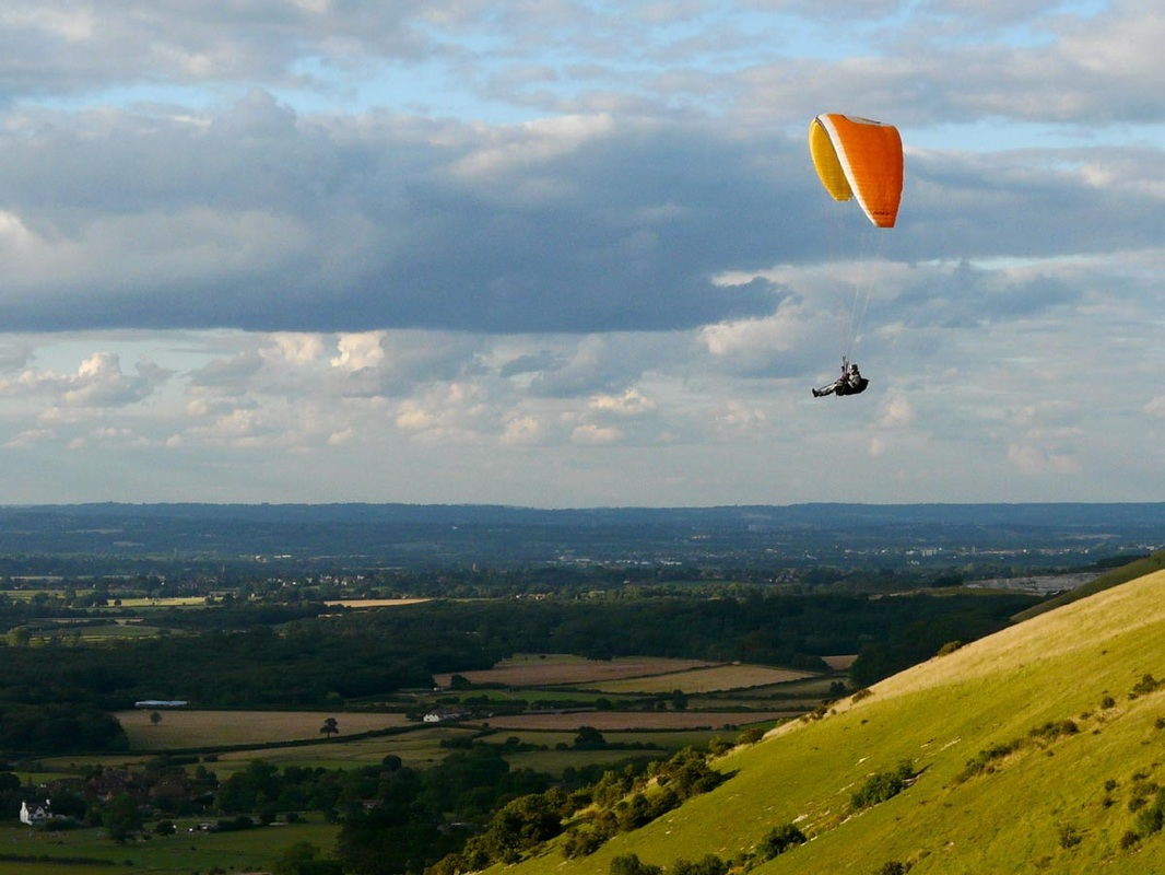 Paraglider and view from hill