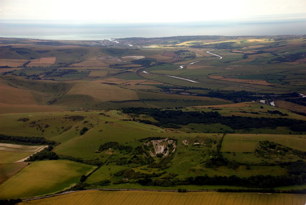 Aerial type shot of hills and winding river leading to sea