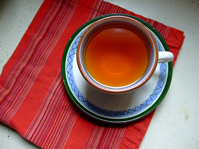 Cup of tea on red placemat
