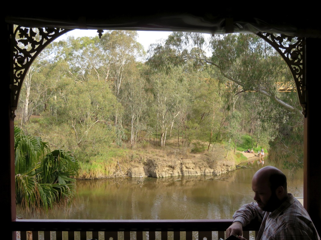 Brown river framed with lace verandah