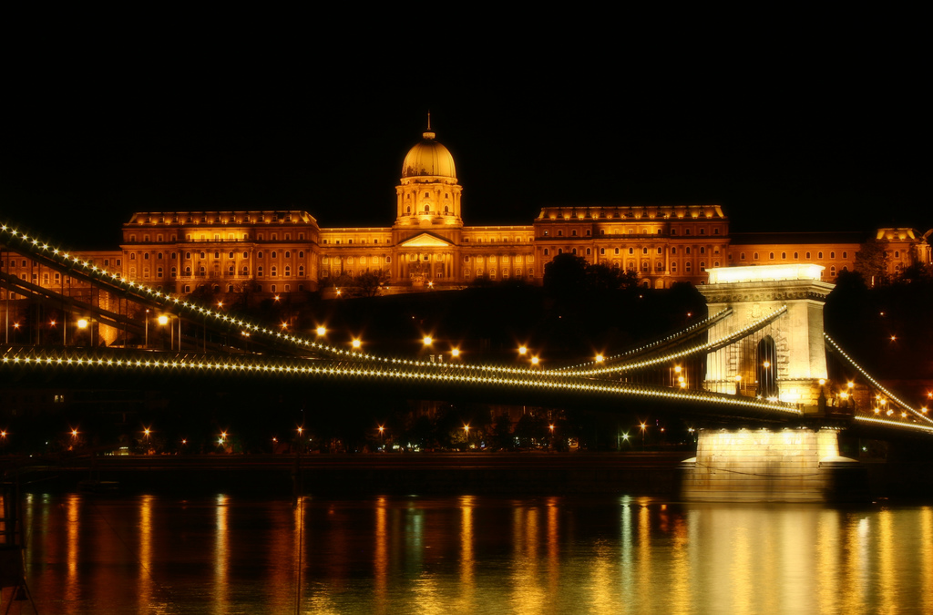 Night: lit bridge and palace reflected in river
