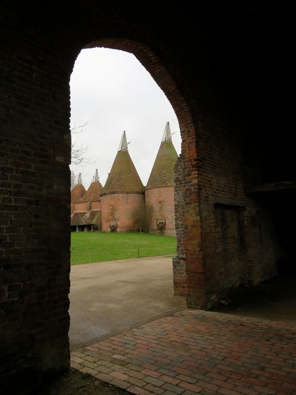 oast houses through an archway