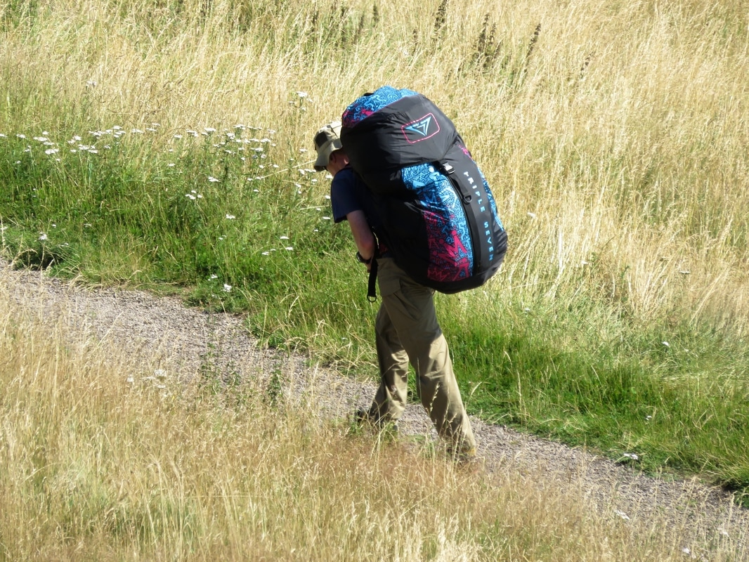 person walking with large pack