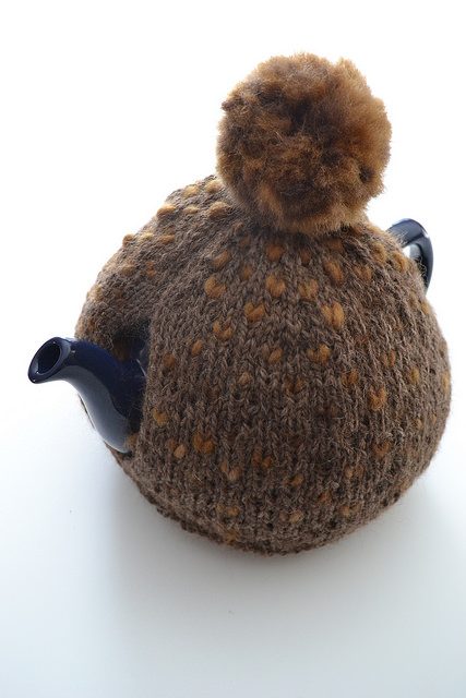 Tea pot and brown cosy