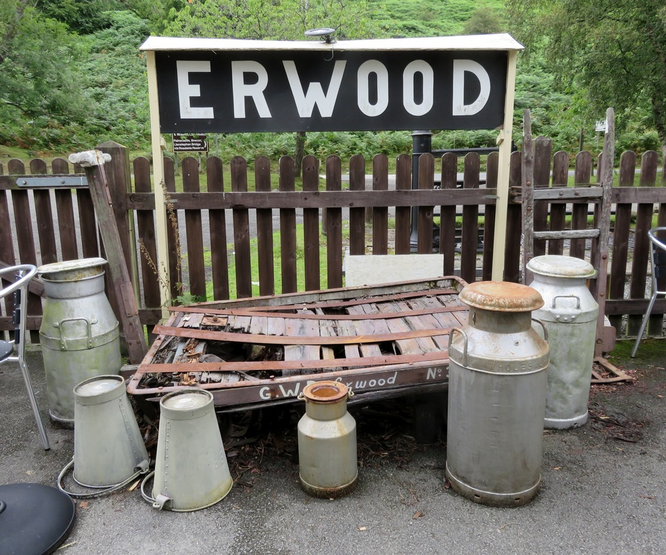Station sign and milk churns