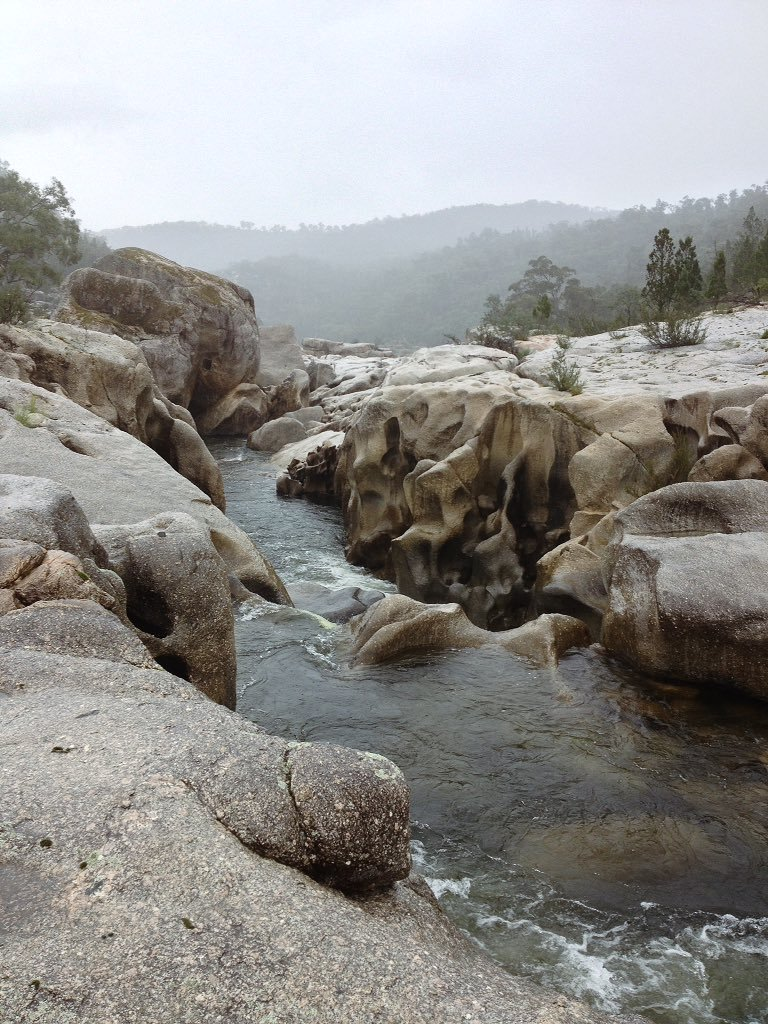 River, granite boulders and rain