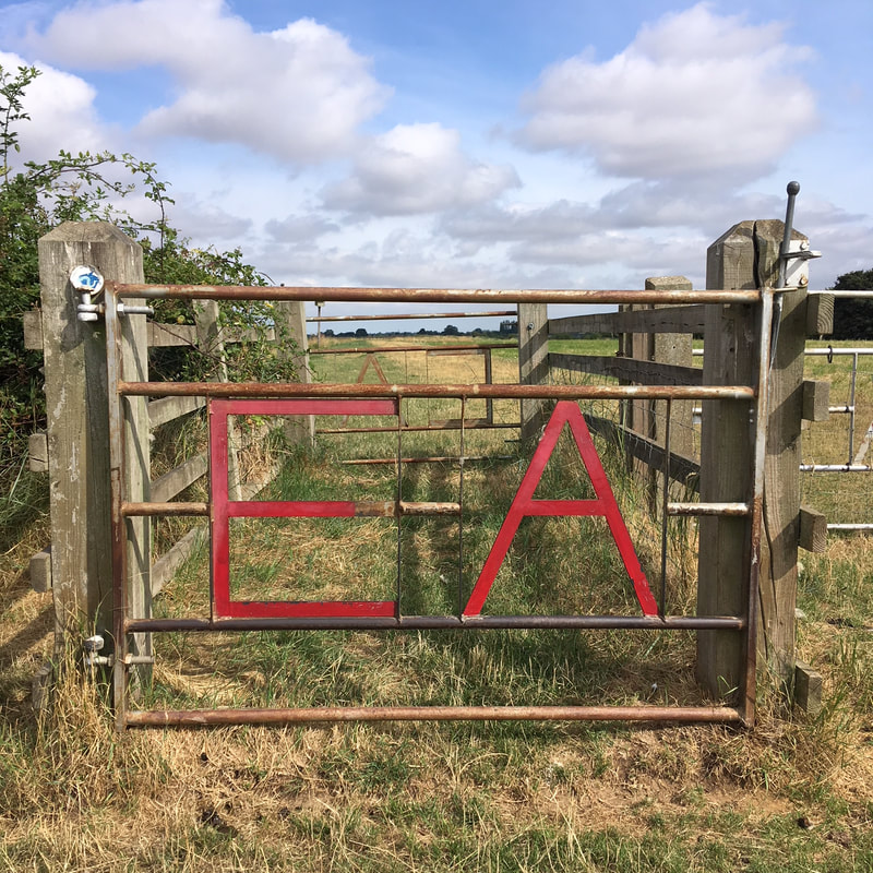 Barred gate with EA in red text