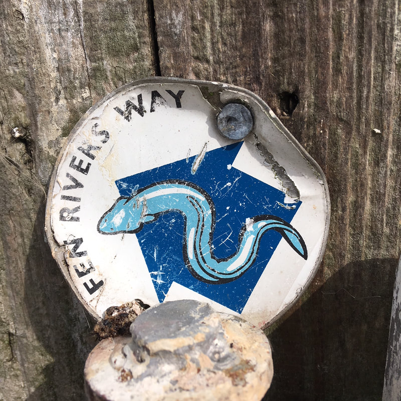 Waymarker with an eel on it