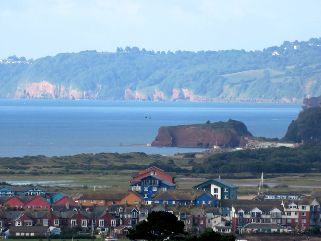 view of houses, seaside and cliffs