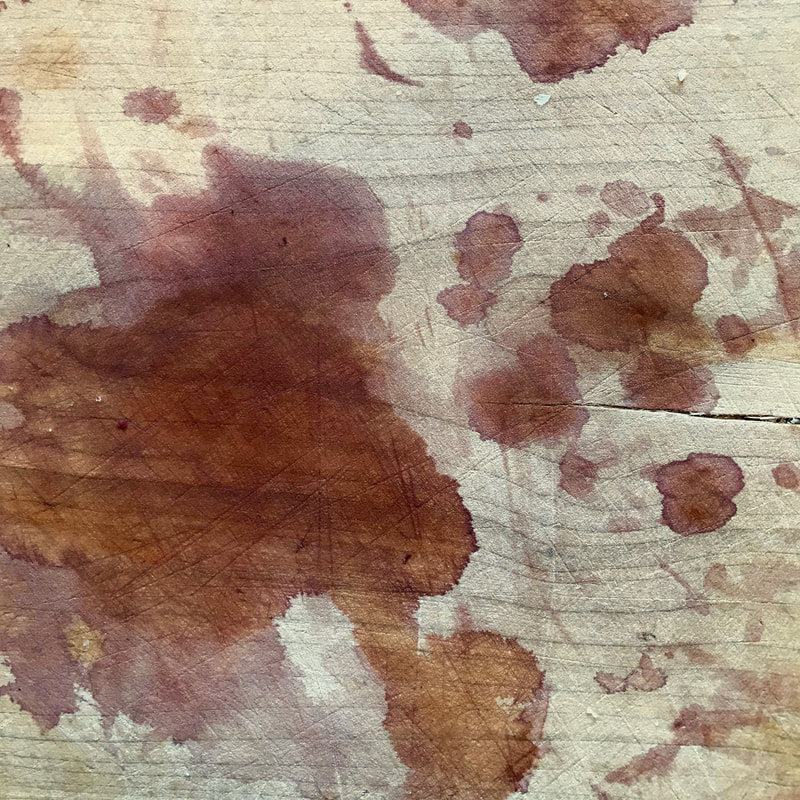 Wooden chopping board with splotchy stains