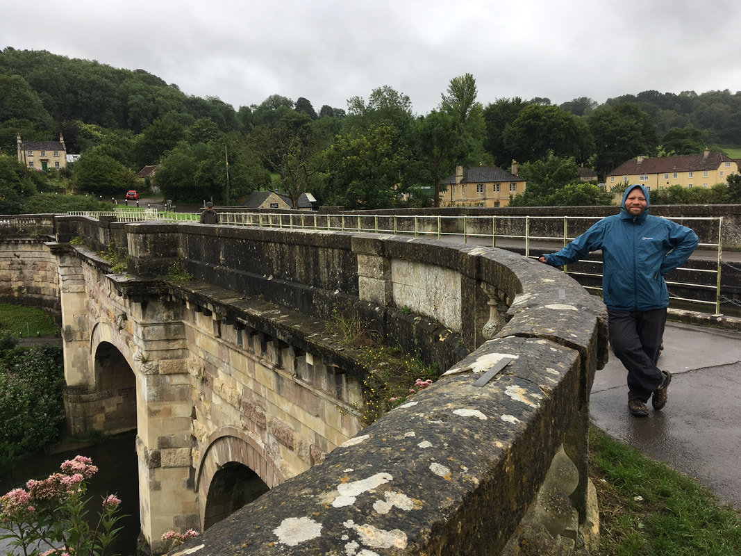 person on bath stone bridge structure