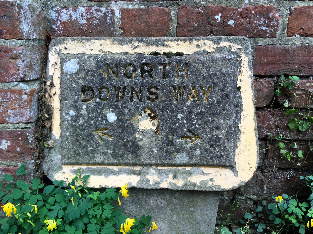 Concrete sign saying North Downs Way
