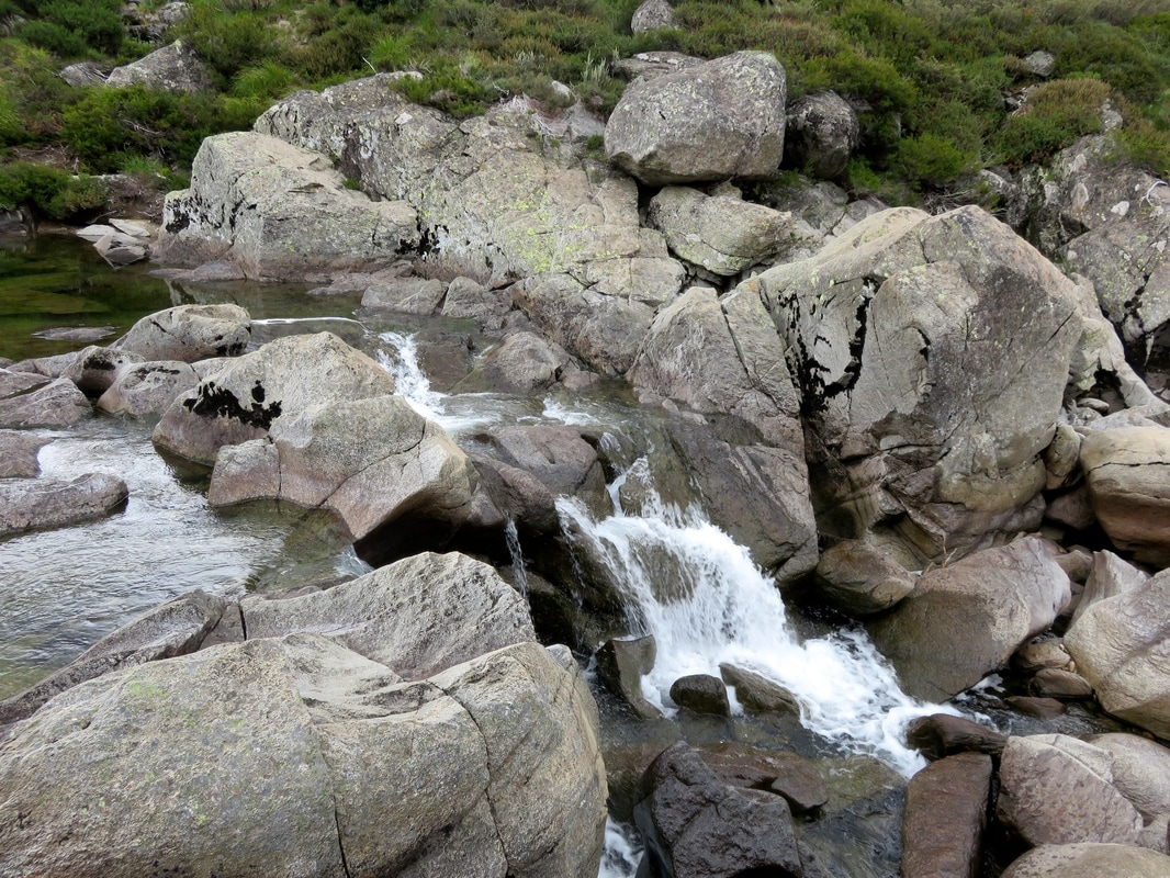 A small waterfall and granite boulders