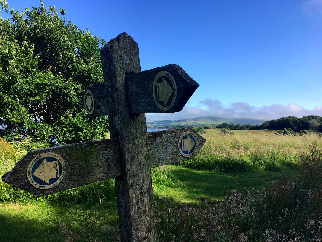 Footpath signpost and sunny scene